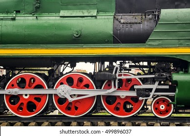 Locomotive side view. Close-up shoot of big loco wheels