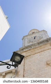Locorotondo, Italy - The gorgeous white town in province of Bari, chosen among the top 10 most beautiful villages in Southern Italy. Clock at Comunale library.