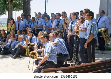 LOCOROTONDO ITALY: Musicians at Locorotondo, Italy - 14 July 2018 - The gorgeous white town in province of Bari, chosen among the top 10 most beautiful villages in Southern Italy