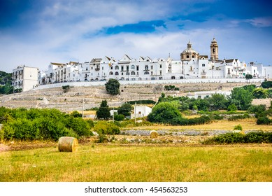 Locorotondo, Italy. Panoramic view of whitwashed city in Italian region of Puglia (Apulia). Town known for its wines and for its circular structure which is now a historical center.