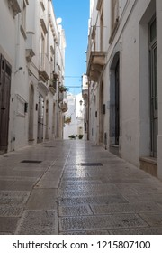 Locorotondo Italy, September 2018. White washed buildings on a street in Locorotondo in Puglia, Southern Italy.