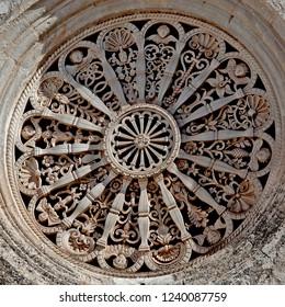 Locorotondo, Puglia, Italy, October 2018: the beautifully sculpted rose window of the Chiesa Madonna della Greca church in the town of Locorotondo in the region of Puglia, southern Italy.