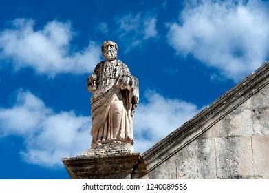 Locorotondo, Puglia, Italy, October 2018: statues on the roof of the Chiesa Madonna della Greca church in the popular tourist town of Locorotondo in the region of Puglia, southern Italy.