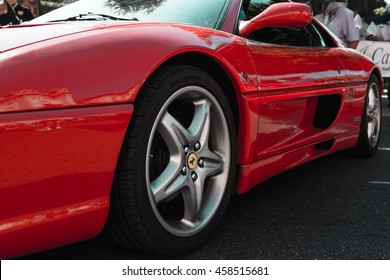 LOCRI-ITALY: CIRCA JULY 2016: Red Ferrari F355 Berlinetta in the Street. Particular of Frontal Wheel. Filter Applied.