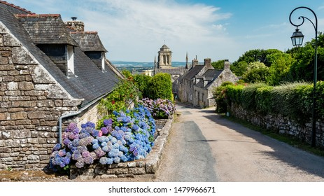 LOCRONAN, FRANCE - AUGUST 23, 2019 -Street view of Locronan, with its splendid cobbled streets and traditional architecture, it's perhaps the prettiest village in this region of France