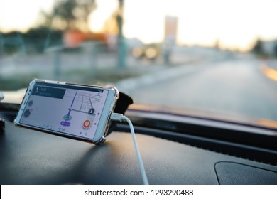 Lod, Israel. January 19, 2019. Popular application Waze on smartphone in a car. Waze enables drivers to  use live maps, real-time traffic updates and turn-by-turn navigation for an optimal commute.