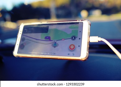 Lod, Israel. January 19, 2019. Smarthphone in a car with popular navigation app Waze on the screen.