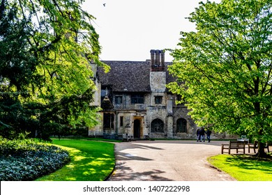 Lode, Cambridgeshire /  UK - MAY 11 2019: old building in the park between green trees with road leading to the building