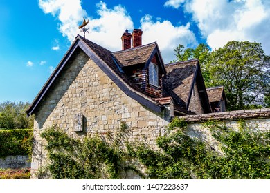 Lode, Cambridgeshire /  UK - MAY 11 2019: old building in the park with blue sky and white clouds above the building