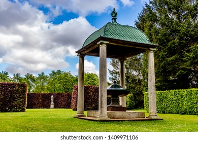 Lode, Cambridgeshire /  UK - MAY 11 2019: pavilion with with white columns and green fountain in the park