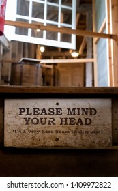 Lode, Cambridgeshire /  UK - MAY 11 2019: please mind your head sign on old wooden steps