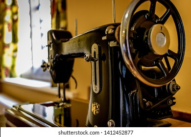 Lode, Cambridgeshire /  UK - MAY 11 2019: old sewing black machine in the room with back light from window