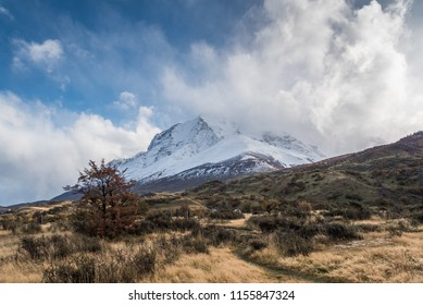 Lodge Paine Grande with cloudy blue sky, Typical weather of Patagonia, Argentina
