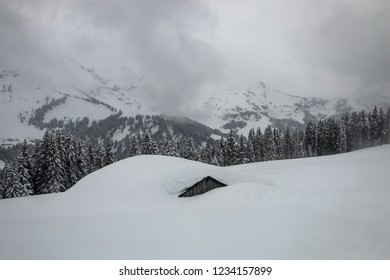 lodge under snow , Range of Mont-Blanc from Megève, in winter , Alps, French