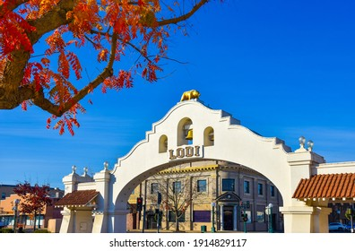 Lodi, California USA  December 15, 2020 Lodi Arch with clear blue sky background and colorful leaves on the foreground