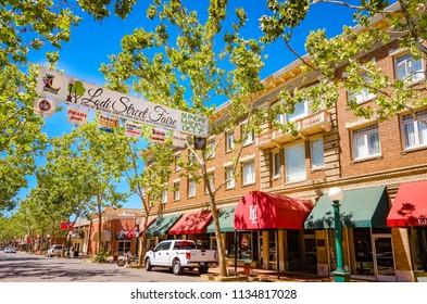 Lodi, California, USA  July 15th, 2018 Downtown Lodi with Lodi Street Fair 2018 signage