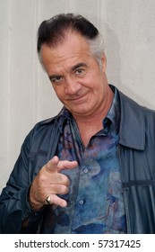LODI, NJ - OCT. 1: Tony Sirico, known as Paulie Walnuts in The Sopranos, poses for a photograph outside the Bada Bing on October 1, 2003 in Lodi, NJ.