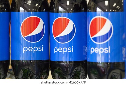 LODI, WI/USA - July 26, 2015: Two liter bottles of regular Pepsi stacked on a store shelf. Pepsi is a major brand of soft drink distributed throughout the world since it's inception in 1893.