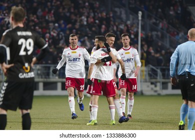 LODZ, POLAND – 03 02 2019: Polish 1st Division Football League. Round 22 game LKS Lodz - Garbarnia Krakow. LKS players Rozwandowicz, Ramirez, Kalinkowski, Bielak are celebrating scored goal.