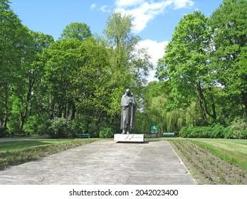 Lodz - Poland. 17 August 2019:  Monument to famous Polish priest, philosopher, geologist, writer, poet, translator and statesman Stanislaw Staszic in Lodz. Monument to Stanislaw Staszic in city park