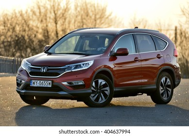 LODZ, POLAND - APRIL 04, 2016 : Honda CR-V. Honda car on the street. Lodz, Poland