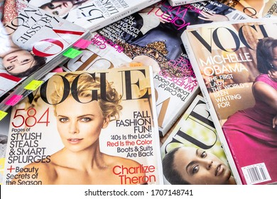 Lodz, Poland, April 18, 2020 a stack of American Vogue fashion magazines, cover with actress Charlize Theron from Vogue US September 2009