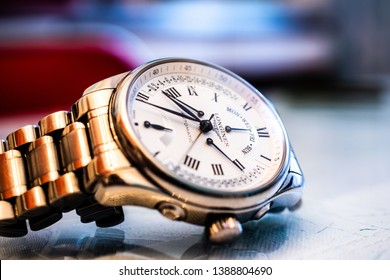 Lodz, Poland, April 21, 2019: Longines hand watch, macro, luxury watch company, Longines winged hourglass logo registered in 1889 is oldest unchanged trademark