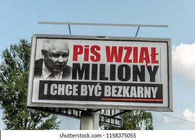 "Lodz, Poland, August 17, 2018: Local government Election campaign in Poland, election slogan: ""PIS wzial miliony i chce byc bezkarny"" PIS took millions and wants to be unpunished"