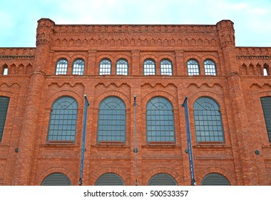 LODZ, POLAND - AUGUST 24, 2014: Facade of the former weaving mill I. Poznanskogo