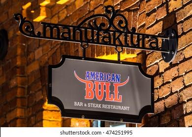 Lodz, Poland, August 26, 2016, night, American Bull Bar & Steak restaurant sign, neon