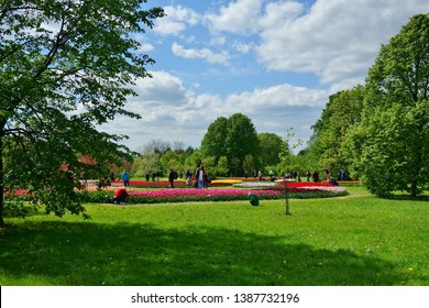 LODZ, POLAND, BOTANICAL GARDEN, MAY  03 2019; Botanical Garden in Lodz. Family walks. Sunday rest. Beautiful tulips in the Lodz, botanical garden