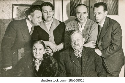 LODZ, POLAND, CIRCA 1950's: Vintage photo of family posing together