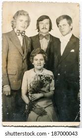 LODZ, POLAND, CIRCA 1950's: Vintage photo of newlyweds with bestmen