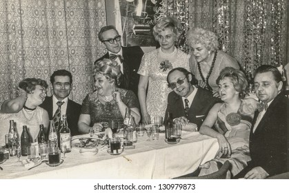 LODZ, POLAND - CIRCA 1960: a group of unidentified friends and family has fun together during a carnival party circa 1960 in Lodz, Poland