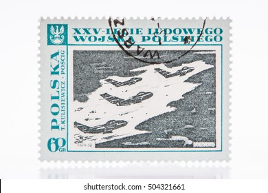 "Lodz, Poland, circa 1968 a stamp shows a battle scenery,  painting ""Pursuit"" (Mikoyan Gurevich MiG-17 aircraft) by Kulisiewicz, the series ""The 25th Anniversary of the Polish People's Army"","