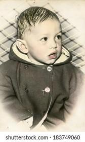 LODZ, POLAND, CIRCA 1970: Vintage photo of little boy
