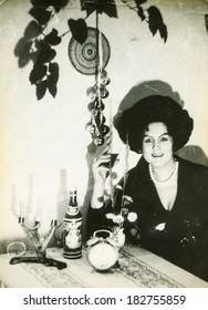 LODZ, POLAND - CIRCA 1970's: Vintage photo of woman drinking some wine