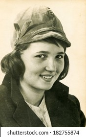 LODZ, POLAND - CIRCA 1970's: Vintage photo of young girl in hat