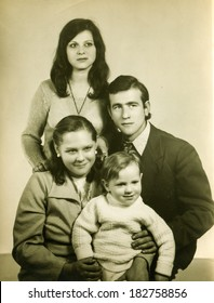 LODZ, POLAND, CIRCA 1970's - vintage photo of family with a baby at his christening