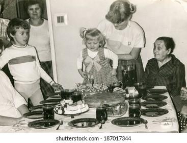 LODZ, POLAND CIRCA 1970's: Vintage photo of family enjoying a family party (child birthday)