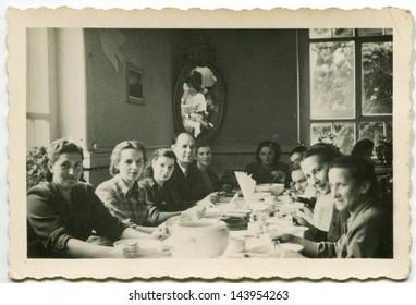 LODZ, POLAND, CIRCA FIFTIES - vintage photo of people enjoying a family dinner, Lodz, Poland, circa fifties