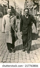LODZ, POLAND, CIRCA FIFTIES - Vintage photo of two men walking down the street