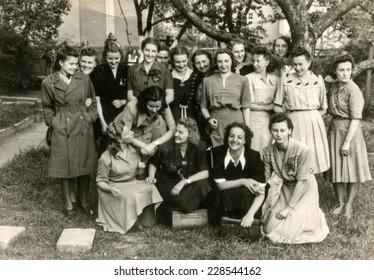 LODZ, POLAND, CIRCA FIFTIES: Vintage photo of group of female schoolmates