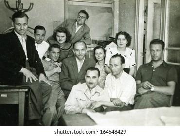 LODZ, POLAND - CIRCA FORTIES: Vintage photo of group of clerks in office, Lodz, Poland, circa forties