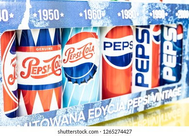 Lodz, Poland, December 21, 2018: Pepsi Cola cans 1960s 1980s 1990s 2000s GENERATIONS Edition, Pepsi-Cola is produced by Pepsico, macro closeup