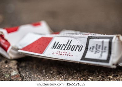 Lodz, Poland, December 23, 2018 pack of Marlboro cigarettes, worn and thrown away, lusts health of man and nature, Marlboro is brand owned by Philip Morris International, Smoking kills