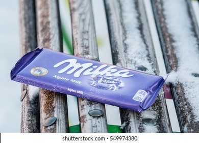 Lodz, Poland, January 06, 2017: A bar of Milka Mondelez Alpenmilch milk chocolate with the purple cow