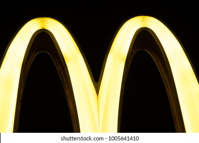 Lodz, Poland, January 1, 2018 yellow McDonald's sign, night, clouds, McDonald's was founded in 1940 as restaurant operated by Richard and Maurice McDonald, in San Bernardino, USA