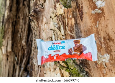 Lodz, Poland, January 28, 2017: Kinder Delice Chocolate Candy Bar made by Ferrero, trunk, tree bark