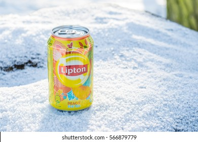 Lodz, Poland, January 28, 2017: Lipton Ice Tea Peach drink is a brand sold by Lipton, winter, snow